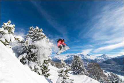 Canvas print  Snowboarder jumps over trees - Roland Hemmi