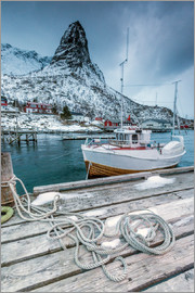 Roberto Moiola - A boat moored in the cold sea in the background the snowy peaks. Reine. Lofoten Islands Northern Nor