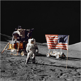 Stocktrek Images - Apollo 17 astronaut stands near the United States flag