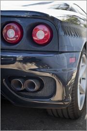 Exhaust of a black Ferrari