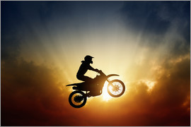Biker jumping at sunset