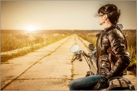 Biker girl in a brown leather jacket