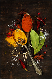 Bright spices on an old wooden board