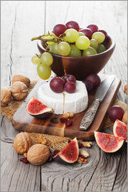 Camembert cheese with figs, nuts and grapes