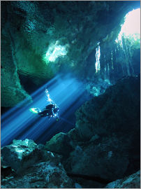 Karen Doody - Diver silhouetted in sunrays of cenote system on Mexico's Yucatan Peninsula.