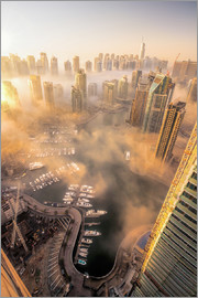 Dubai Marina covered in early morning fog