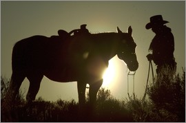 Josh Anon -  A cowboy and his horse at sunset