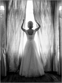 Elegant bride at big window