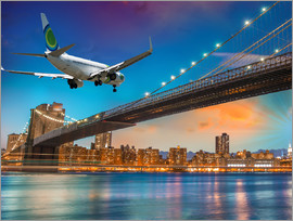 Aircraft flying over Brooklyn Bridge in New York