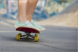 Feet of a young woman with skateboard