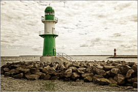 Green and red lighthouse at the harbor entrance of Warnemünde