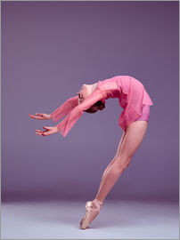 Young ballerina in pink dress