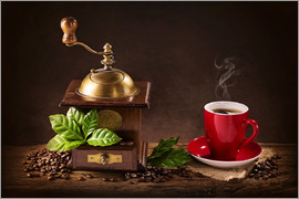 Elena Schweitzer - Coffee mill with beans and green leaves and a cup of coffee