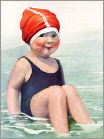 Child Wearing a Swim Cap Sitting in the Surf