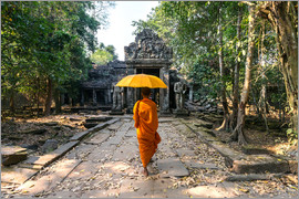 Matteo Colombo - Monk with umbrella walking in Angkor Wat temple, Cambodia