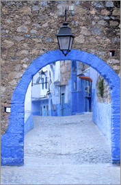 Brenda Tharp - Morocco, Chefchaouen. A blue arch and quiet street entering the medina of the village.