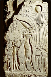 Pharaoh Akhenaten pays homage to the sun god Aten