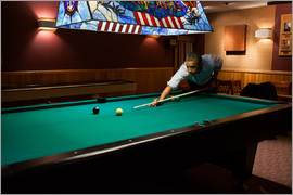 President Barack Obama plays a game of pool
