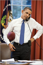 President Barack Obama talks on the phone