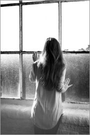 Pixtal - Rear view of a woman waiting by the window.