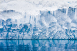 Reflection of a glacier with icicles
