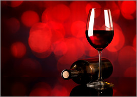 Red wine in wineglass and bottle