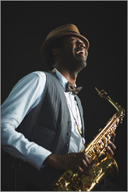 Saxophonist with hat and bow tie