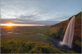Christian Kober - Seljalandsfoss waterfall at sunset