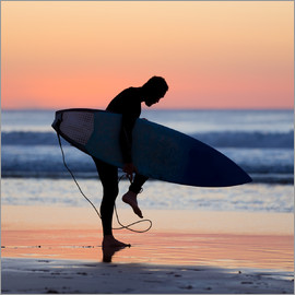 Silhouette of male surfer on the beach