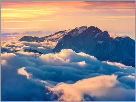 sunrise on the foggy Val di Fassa valley with passo Sella, Dolomites