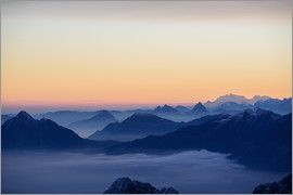 Peter Wey - Distant mountain layers at sunrise. View from Brienzer Rothorn over swiss alps
