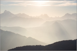 Fabio Lamanna - Sunlight behind mountain peaks silhouette, the Alps