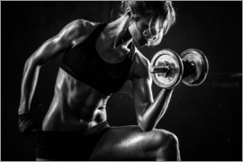 Sportswoman with dumbbells