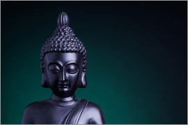 Statue of the Buddha with green back light