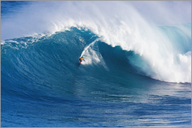 MakenaStockMedia - Surfer rides a giant wave