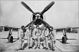 Test pilots stand in front of a P-47 Thunderbolt.
