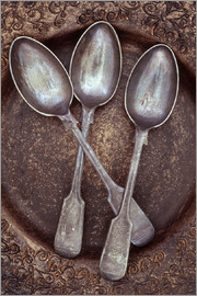 Trigger Image - Three antique tarnished silver teaspoons lying in brown and gold bowl with ornate pattern