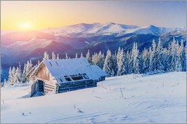 Snowy hut at sunset