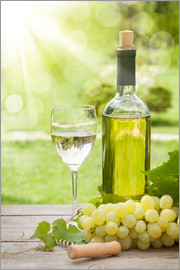 White wine glass and bottle