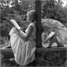 SuperStock - Mother and daughter are reading
