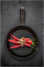 Wood print  Chili peppers in black iron pan - Uwe Merkel