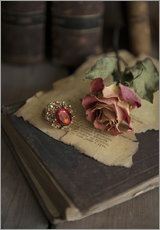 Old books, ring, letters and dry rose