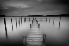 Old wooden pier in the still waters