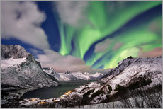 Aurora Borealis or northern lights over winter landscape