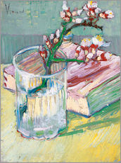 Flowering almond branch in a glass with a book