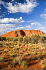 Uluru or Ayers Rock, under a blue sky