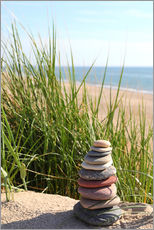 A Tower of Stones on a Dune at the Sea