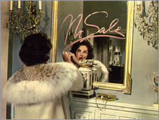 Elizabeth Taylor in front of a mirror