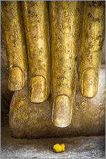 Golden fingers of a Buddha statue