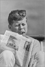 John F. Kennedy with a newspaper